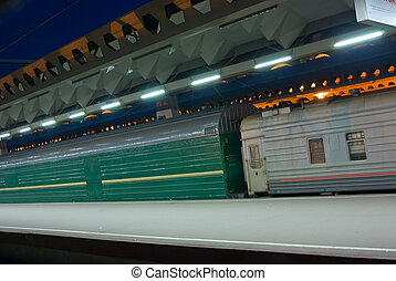 Transportations - Evening, train on a platform in...