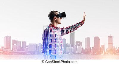 Guy wearing checked shirt and virtual mask stretching hand to touch something