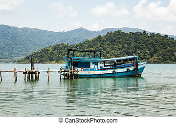 Fishing boat moored at old wharf - Fishing boat moored at...