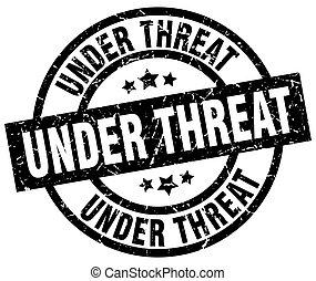 under threat round grunge black stamp
