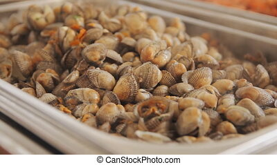 A lot of cooked clams at the market. Boiled tasty clams....