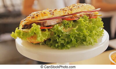 Sandwich on a plate close-up. Handheld shot. Sandwich with...