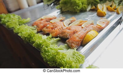 Baked red salmon with salad. Cooked fish fillets with greens...