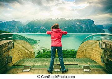 Tourist on Stegastein viewpoint, Norway - Tourist woman on...
