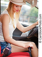 driver hand shifting the gear stick