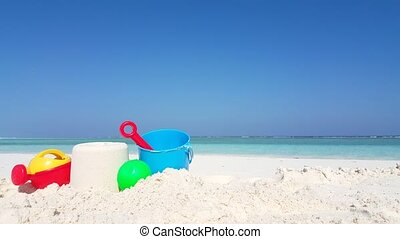 Maldives beautiful beach background white sandy tropical paradise island with blue sky sea water ocean 4k bucket spade