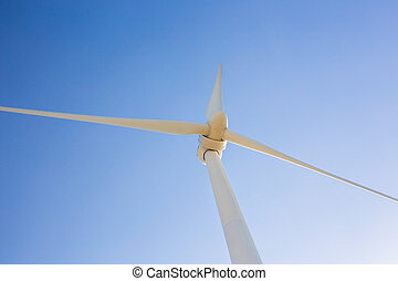 Wind turbine generating electricity with blue sky - energy...