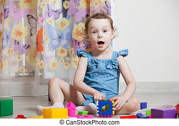 beautiful girl plays toys in room