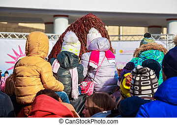 Back view children in winter clothes on festival
