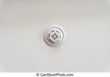 Smoke detector on a ceiling - Close up white smoke detector...