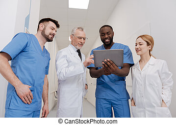 Positive medics using tablet in the hospital - Sharing...