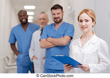 Charming female practitioner working in the clinic -...