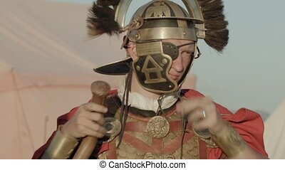 Ancient Roman Centurion in the camp outdoors