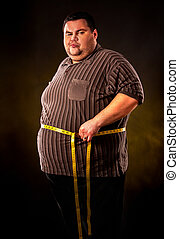 Man belly fat with tape measure weight loss around body . -...