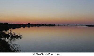 African sunset on Zambezi river - African sunset on big...