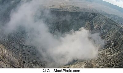 Crater of Bromo vocalno, East Java, Indonesia, Aerial view -...