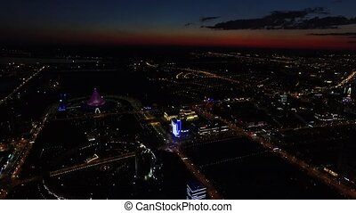 Astana, Kazakhstan. Aerial night view over center of city -...