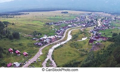 Aerial views of village Tyulyuk near of mount Iremel in the Southern Urals