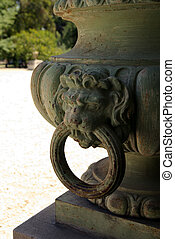 antic white vase with a lion head