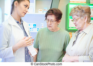 Pharmacist recommending product to customers