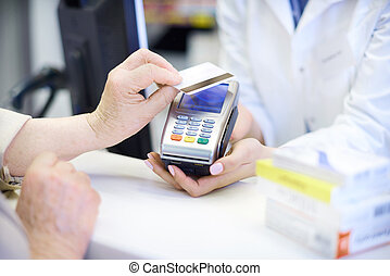 Close up of contactless payment at pharmacy