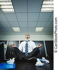 businessman doing yoga in office - stressed businessman...
