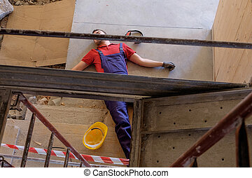 Worker in a faint after on-the-job injury - Worker in a...