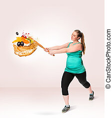 Unhealthy food and fat woman - A fat woman smashing a sweet...