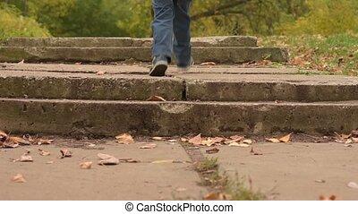 Autumn park activity. Playful three years old boy running...