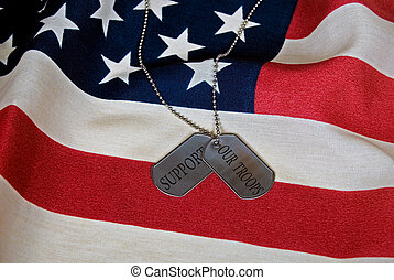 Support Our Troops - Dog tags on American flag.
