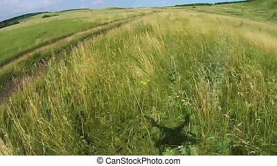 flight to drone on country road in Bashkiria