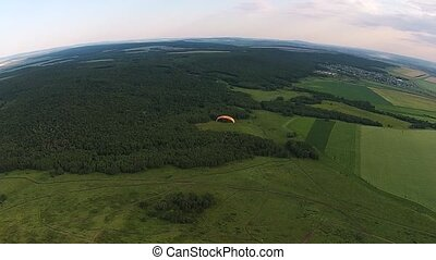 Aerial view of paragliding near the mountain solitary...
