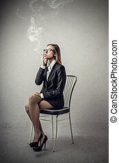 Business woman and cigarette - Business woman smoking at...