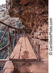 Precarious Plank Bridge On Cliff Connects Trails