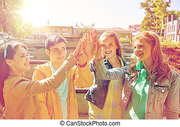 happy students or friends making high five