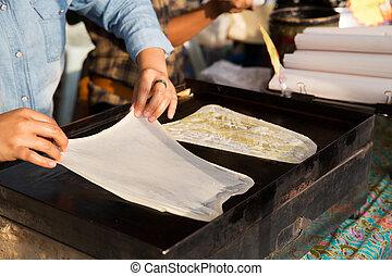 woman cooking roti pancakes at street market - cooking,...
