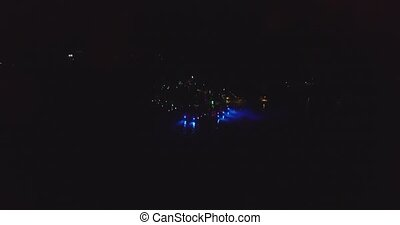 Party on club in Goa, India. Aerial view. Night - Dancing on...