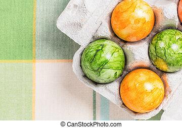 Colored eggs in box