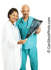Medical Team With CT Scan - Attractive doctors holding a CT...