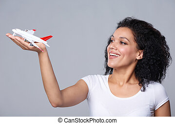 Woman launching airplane - Closeup portrait of happy...