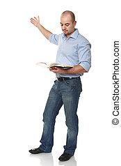 caucasian standing man with book - caucasian standing man...