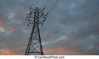Electrical pylon. Sunset timelapse