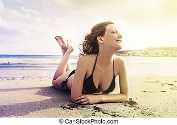 Woman on beach in the sand