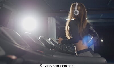 Fit women running on treadmills in the gym
