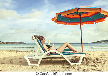Woman on beach chair