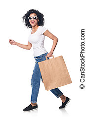Woman with shopping bag running - Full length happy mixed...