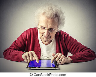 Old lady with tablet - Old lady using tablet