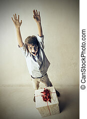 Boy cheering for gift