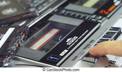 Audio Cassette Playing. Close-Up. Pushing a Finger Button...