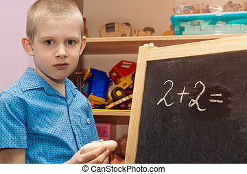 chalky boy on a blackboard - The picture shows a chalky boy...
